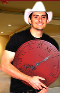 Brad Paisley holding his personalized wall clock