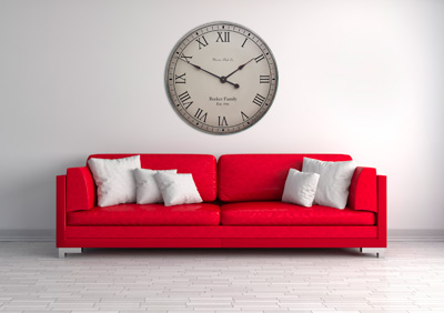 Gray antiqued clock above red sofa