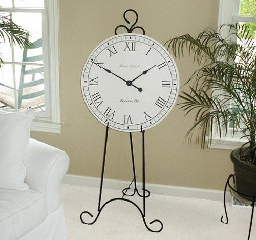 White Original clock on a floor easel